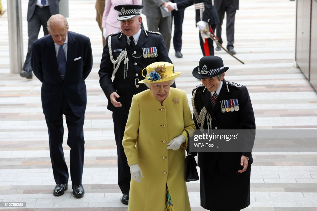 Queen Elizabeth II (C) and Prince Philip, Duke of Edinburgh (L) are accompanied by Commissioner of the Metropolitan Police Cressida Dick (R) and Deputy Commissioner of the Metropolitan Police Craig Mackey as they arrive at the opening of the the new headquaters of the Metropolitan Police Service on July 13, 2017 in London, England.