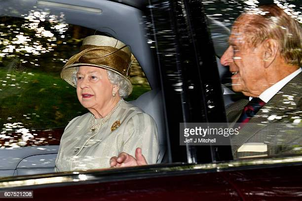 Queen Elizabeth II and Prince Philip Duke of Edinburgh are driven from Crathie Church on September 18 2016 in Crathie Scotland Prime Minister Theresa...