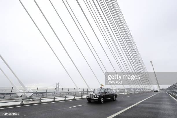 Queen Elizabeth II and Prince Philip Duke of Edinburgh are driven across the bridge during the official opening of the Queensferry Crossing on...