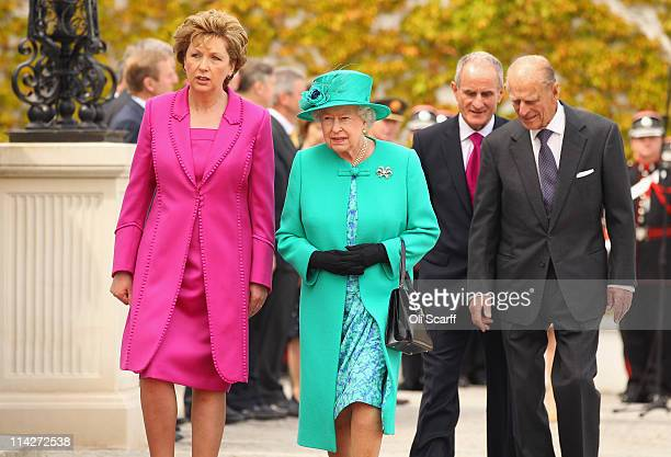 Queen Elizabeth II and Prince Philip, Duke of Edinburgh are greeted by Irish President Mary McAleese and her husband Martin McAleese at the Aras an...