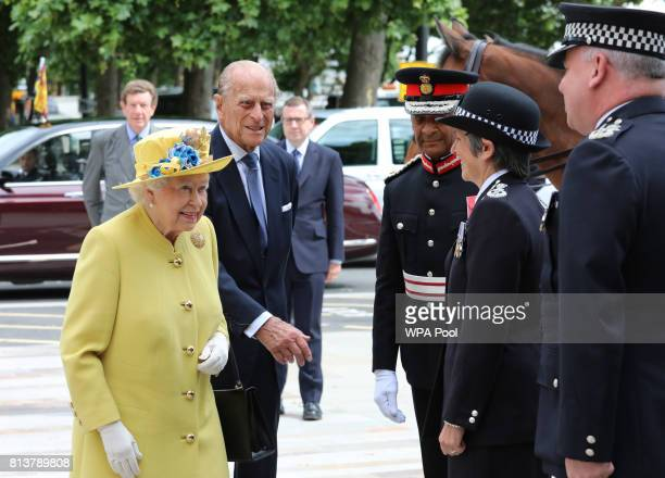 Queen Elizabeth II and Prince Philip Duke of Edinburgh are greeted by Commissioner of the Metropolitan Police Cressida Dick and Deputy Commissioner...