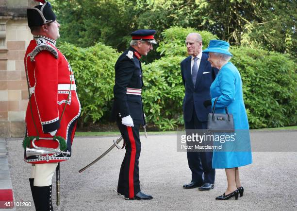 Queen Elizabeth II and Prince Philip Duke of Edinburgh are met by David Lindsay Lord Lieutenant of County Down as they arrive at Hillsborough Castle...