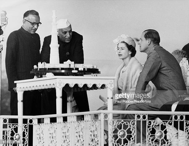 Queen Elizabeth II and Prince Philip Duke of Edinburgh are shown a model of the minaret Qutb Minar hand carved in ivory and mounted on ebony by Prime...