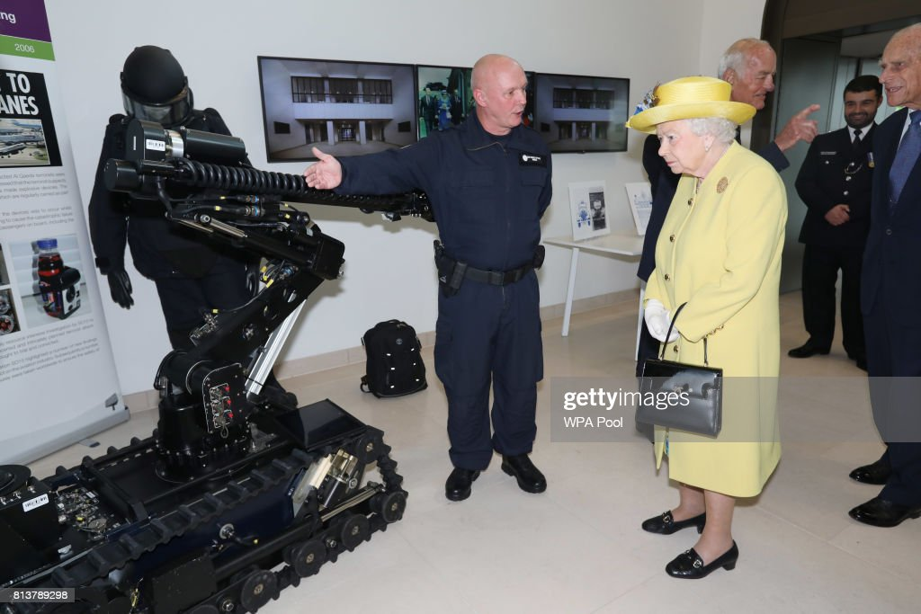Queen Elizabeth II and Prince Philip, Duke of Edinburgh are shown a bomb disposal robot during the opening of the the new headquaters of the Metropolitan Police Service on July 13, 2017 in London, England.