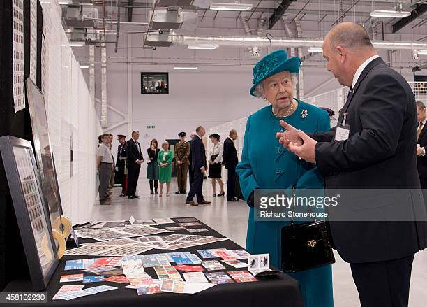 Queen Elizabeth II and Prince Philip Duke of Edinburgh are shown examples of stamps produced at the factory by MD Paul White during an official visit...