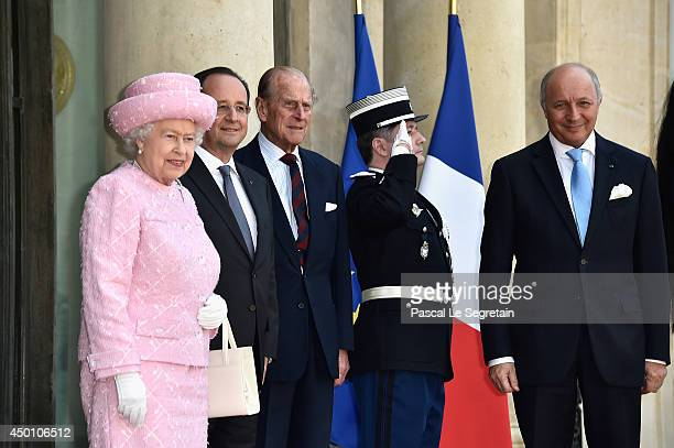 Queen Elizabeth II and Prince Philip Duke of Edinburgh are welcomed by French President Francois Hollande and Minister of Foreign Affairs and...