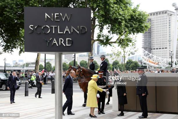 Queen Elizabeth II and Prince Philip Duke of Edinburgh are welcomed to New Scotland Yard by Metropolitan Police commissioner Cressida Dick and...