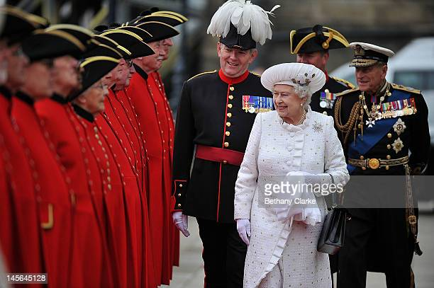 Queen Elizabeth II and Prince Philip Duke of Edinburgh arrive at Chelsea Pier on June 3 2012 in London England For only the second time in its...