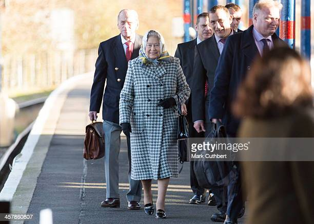 Queen Elizabeth II and Prince Philip Duke of Edinburgh arrive at King's Lynn station after travelling from Kings Cross on a regular train to begin...