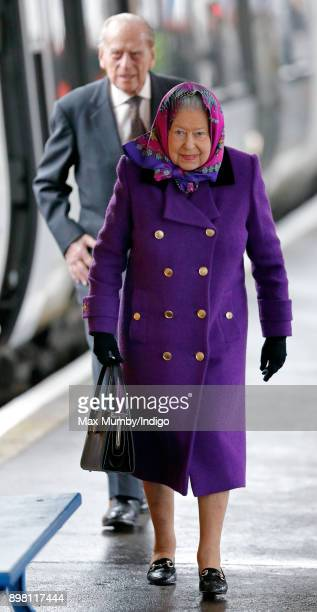 Queen Elizabeth II and Prince Philip Duke of Edinburgh arrive at King's Lynn station after taking the train from London King's Cross to begin their...