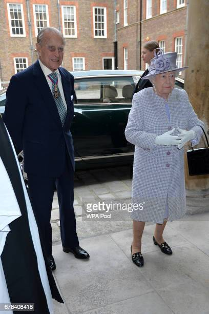 Queen Elizabeth II and Prince Philip Duke of Edinburgh arrive at St James's Palace for a service for members of The Order of The Merit at St James's...