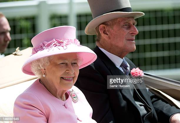 Queen Elizabeth II and Prince Philip, Duke of Edinburgh arrive by carriage on day 2 of Royal Ascot 2012 at Ascot Racecourse on June 20, 2012 in...