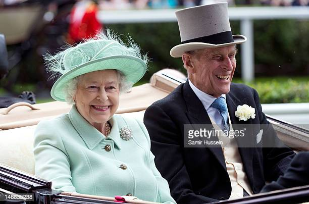 Queen Elizabeth II and Prince Philip Duke of Edinburgh arrive by carriage on Ladies Day of Royal Ascot 2012 at Ascot Racecourse on June 21 2012 in...