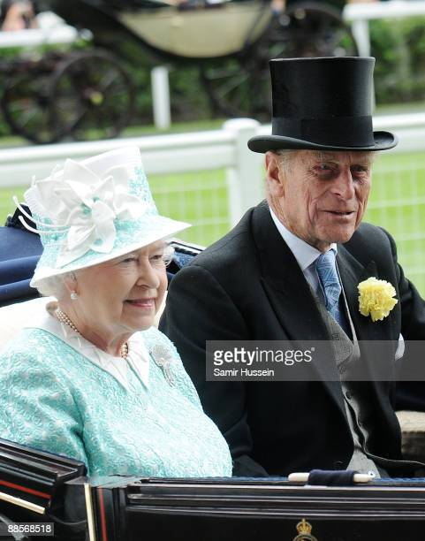 Queen Elizabeth II and Prince Philip Duke of Edinburgh arrive by carriage on Ladies Day of Royal Ascot at Ascot Racecourse on June 18 2009 in Ascot...