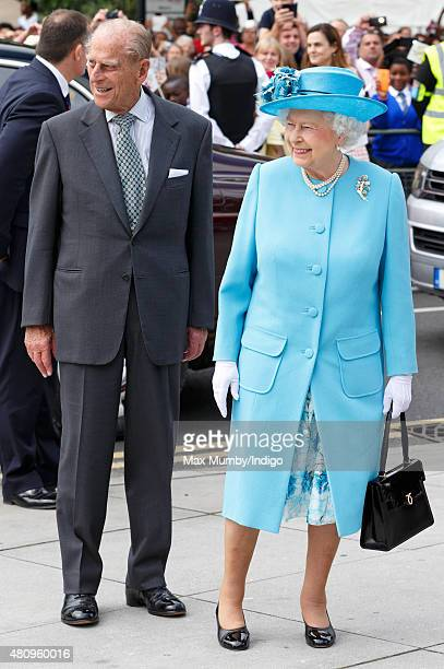 Queen Elizabeth II and Prince Philip Duke of Edinburgh arrive for a visit to the Broadway Theatre during a day of engagements in the London Borough...