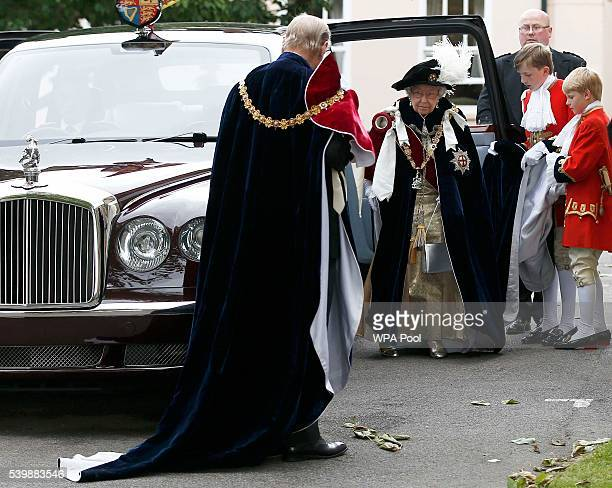 Queen Elizabeth II and Prince Philip Duke of Edinburgh arrive for the annual Order of The Garter Service at St George's Chapel Windsor Castle on June...
