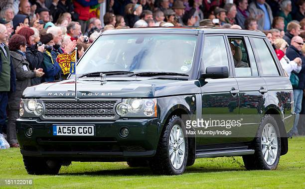 Queen Elizabeth II and Prince Philip Duke of Edinburgh arrive in a Range Rover at the 2012 Braemar Highland Gathering at The Princess Royal Duke of...