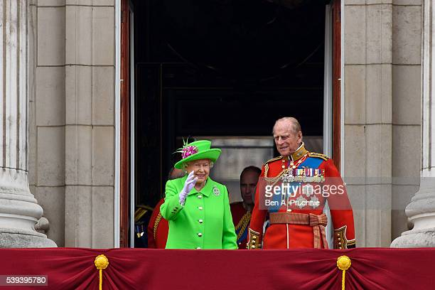 Queen Elizabeth II and Prince Philip, Duke of Edinburgh arrive on the balcony to watch a fly past during the Trooping the Colour, this year marking...