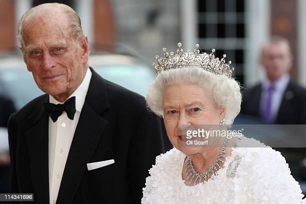 Queen Elizabeth II and Prince Philip Duke of Edinburgh arrive to attend a State Banquet in Dublin Castle on May 18 2011 in Dublin Ireland The Duke...