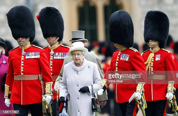 Queen Elizabeth II and Prince Philip, Duke of Edinburgh arrive to inspect the guards during a ceremony to present new colours to the 1st Battalion...
