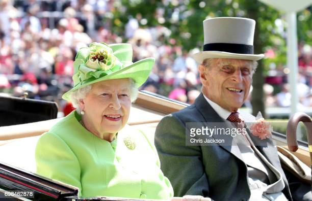 Queen Elizabeth II and Prince Philip, Duke of Edinburgh arrive with the Royal Procession as they attend Royal Ascot 2017 at Ascot Racecourse on June...