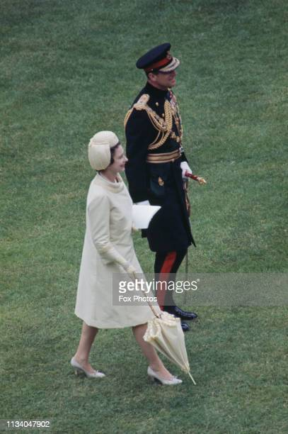 Queen Elizabeth II and Prince Philip, Duke of Edinburgh at the investiture of Prince Charles as Prince of Wales at Caernarfon Castle, Gwynedd, Wales,...