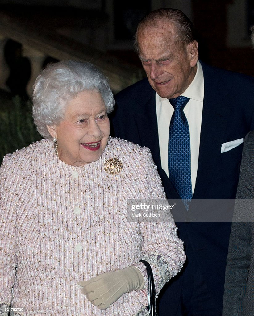 Queen Elizabeth II and Prince Philip, Duke of Edinburgh attend a Co-Operation Ireland Reception at Crosby Hall on November 8, 2016 in London, England. During the reception The Queen unveiled a portrait of herself by artist Colin Davidson.