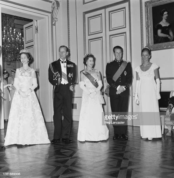 Queen Elizabeth II and Prince Philip, Duke of Edinburgh attend a banquet in Brussels, during a state visit to Belgium, 10th May 1966. From left to...