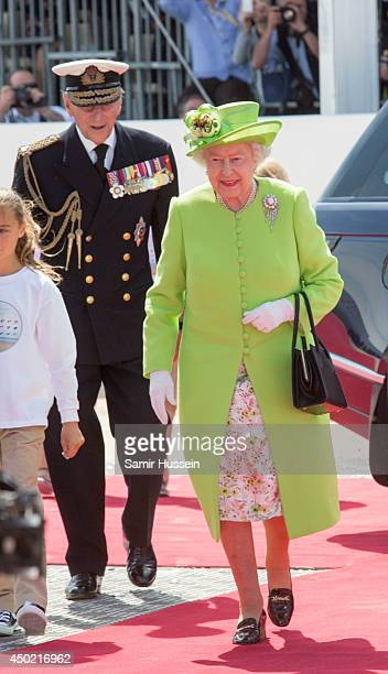 Queen Elizabeth II and Prince Philip Duke of Edinburgh attend a Ceremony to Commemorate DDay 70 on Sword Beach during DDay 70 Commemorations on June...