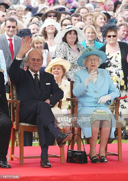Queen Elizabeth II and Prince Philip Duke of Edinburgh attend the Three Counties Diamond Jubilee River Pageant at the Henley Business College on June...