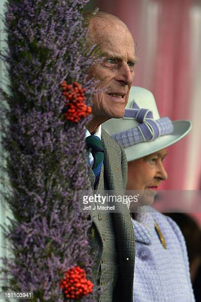 Queen Elizabeth II and Prince Philip Duke of Edinburgh attend the Braemar Highland Games at The Princess Royal and Duke of Fife Memorial Park on...