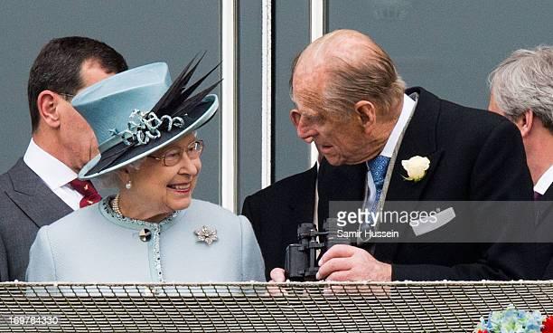 Queen Elizabeth II and Prince Philip, Duke of Edinburgh attend the Investec Epsom Derby at Epsom Racecourse on June 1, 2013 in Epsom, England.