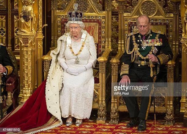 Queen Elizabeth II and Prince Philip Duke of Edinburgh attend the State Opening of Parliament in the House of Lords at the Palace of Westminster on...