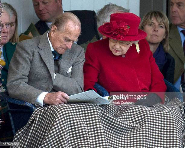 Queen Elizabeth II and Prince Philip Duke of Edinburgh attend the Braemar Gathering on September 5 2015 in Braemar Scotland There has been an annual...