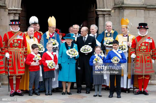 Queen Elizabeth II and Prince Philip Duke of Edinburgh attend the traditional Royal Maundy service at Leicester Cathedral on April 13 2017 in...