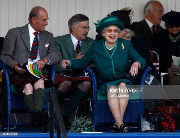 Queen Elizabeth II and Prince Philip, Duke of Edinburgh, attend the Braemar Gathering at the Princess Royal and Duke of Fife Memorial Park on...