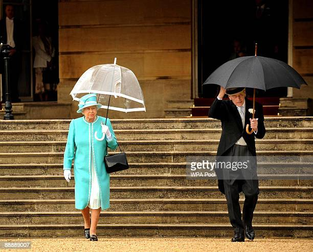 Queen Elizabeth II and Prince Philip Duke of Edinburgh attend the first Royal Garden Party of the summer at Buckingham Palace on July 7 2009 in...