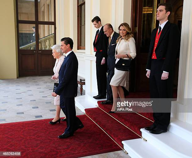 Queen Elizabeth II and Prince Philip Duke of Edinburgh descend the Grand Entrance before bidding farewell to Mexican President Enrique Pena Nieto and...