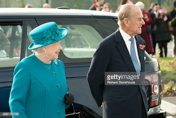 Queen Elizabeth II and Prince Philip, Duke of Edinburgh during an official visit to International Security Printers to view their work on specialist...