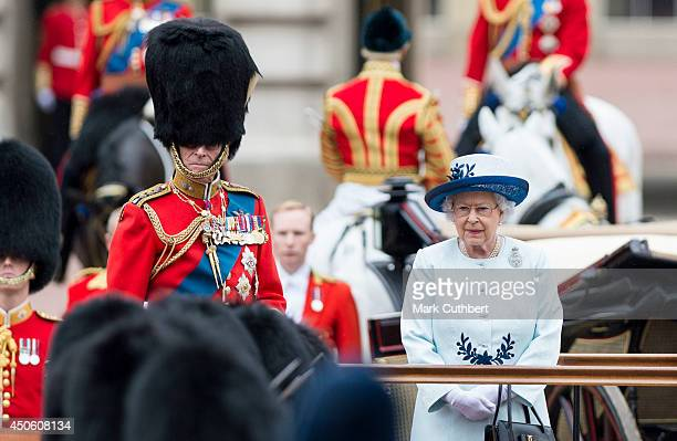 Queen Elizabeth II and Prince Philip Duke of Edinburgh during Trooping the Colour at The Royal Horseguards on June 14 2014 in London England