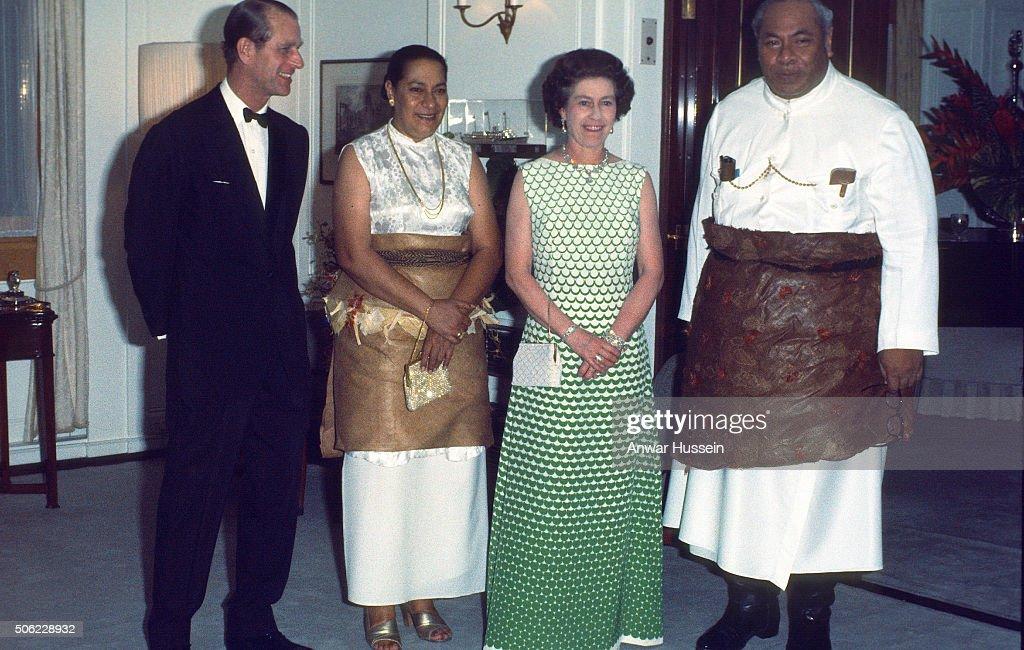 Queen Elizabeth II and Prince Philip, Duke of Edinburgh entertain King Taufa'ahau Tupou IV and Queen Halaevalu Mata'aho 'Ahome'e of Tonga on the Royal Yacht Britannia on February 01, 1977 in Tonga.