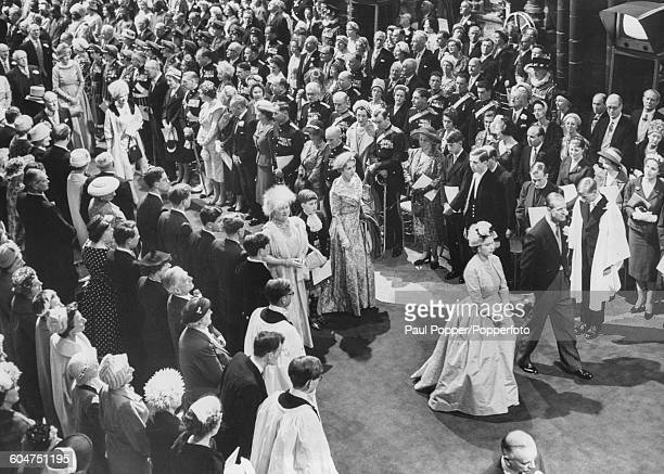 Queen Elizabeth II and Prince Philip Duke of Edinburgh followed by Queen Elizabeth the Queen Mother Prince Charles and Ingrid of Sweden Queen of...
