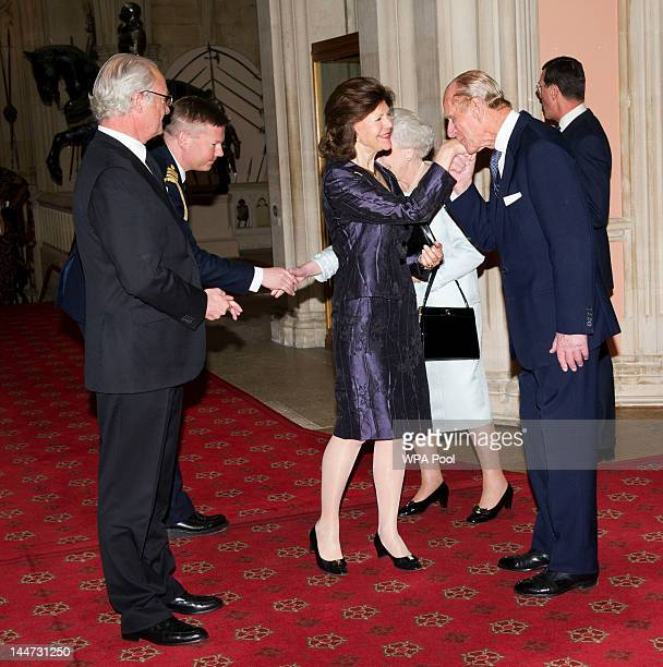 Queen Elizabeth II and Prince Philip Duke of Edinburgh greet King Carl XVI Gustaf of Sweden and Queen Silvia of Sweden as they arrive at a lunch for...