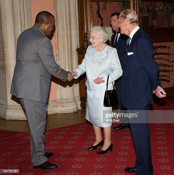 Queen Elizabeth II and Prince Philip Duke of Edinburgh greet King Mswati III of Swaziland as he arrives at a lunch for Sovereign Monarch's held in...