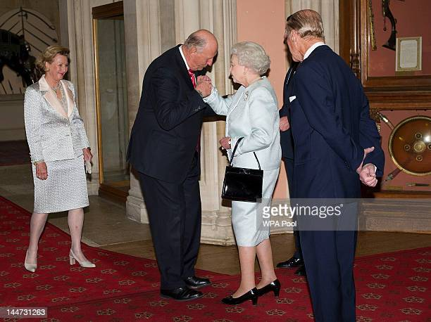 Queen Elizabeth II and Prince Philip Duke of Edinburgh greet King Harald V of Norway and Queen Sonja of Norway as they arrive at a lunch for...
