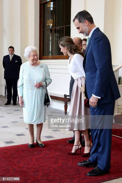 Queen Elizabeth II and Prince Philip Duke of Edinburgh greet King Felipe VI of Spain and Queen Letizia of Spain during a State visit by the King and...
