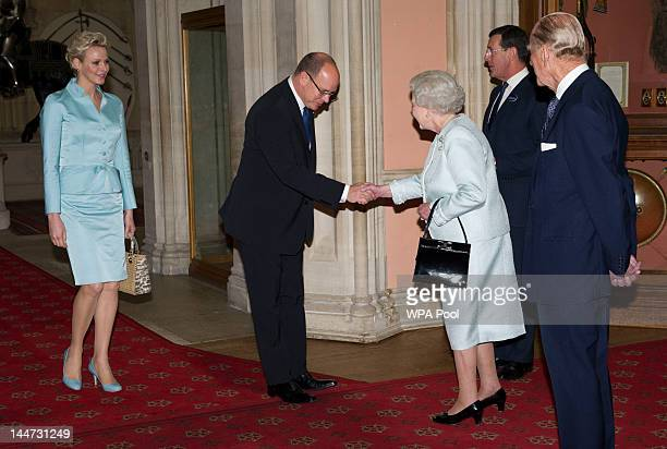 Queen Elizabeth II and Prince Philip Duke of Edinburgh greet Princess Charlene of Monaco and Prince Albert II of Monaco as they arrive at a lunch for...