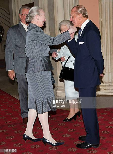 Queen Elizabeth II and Prince Philip Duke of Edinburgh greet Queen Margrethe of Denmark as she arrives at a lunch for Sovereign Monarch's held in...