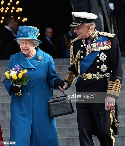 Queen Elizabeth II and Prince Philip, Duke of Edinburgh hold hands as they leave St Paul's Cathedral after a Service of Commemoration for troops who...