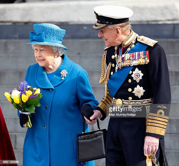 Queen Elizabeth II and Prince Philip Duke of Edinburgh hold hands as they leave a Service of Commemoration to mark the end of combat operations in...